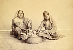 Women selling vegetables from a basket (studio reconstruction)
